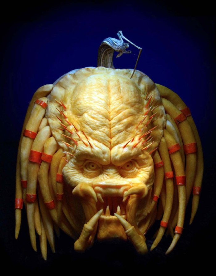 sculpture of the predator's head, made from a carved pumpkin, scary halloween decorations, very detailed and realistic art