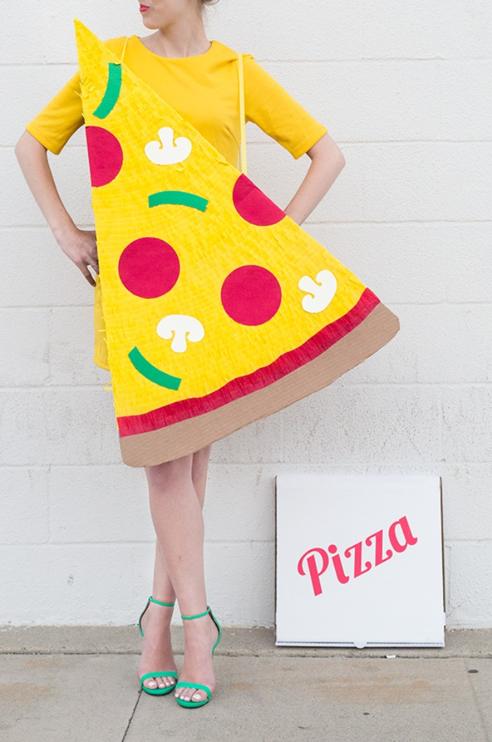 yellow mini dress, and a giant pizza slice, made from carboard and paper, couples halloween costume ideas, delivery guy and pizza