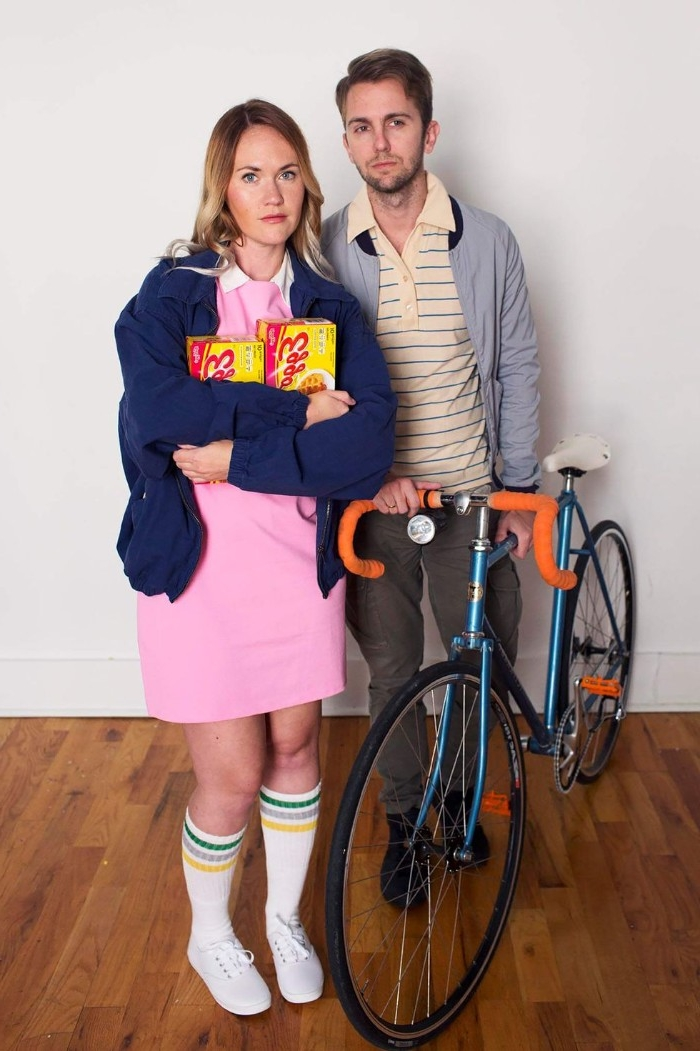 duo halloween costumes, man dressed like mike, and a woman dressed like eleven, from the series stranger things, with bike and eggos