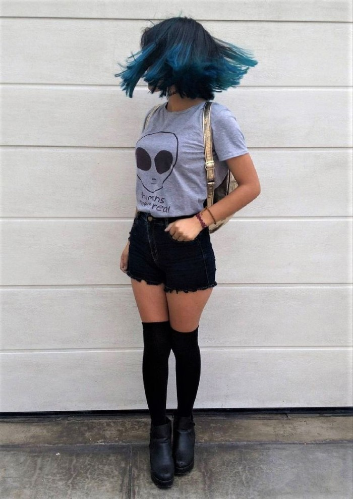 shoulder length ombre hair, in dark and light blue, on a twirling girl, dressed in black cutoff shorts, black over the knee socks, and ankle boots, and a grey t-shirt, featuring an alien print, grunge girl ideas, shiny gold backpack