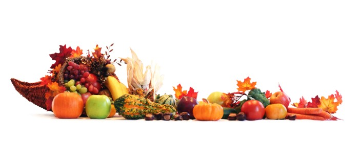 horn of plenty decoration, filled with grapes and fall leaves, small pumpkins and apples, gourds and carrots, and other fruit and vegetables nearby, thanksgiving greeting message