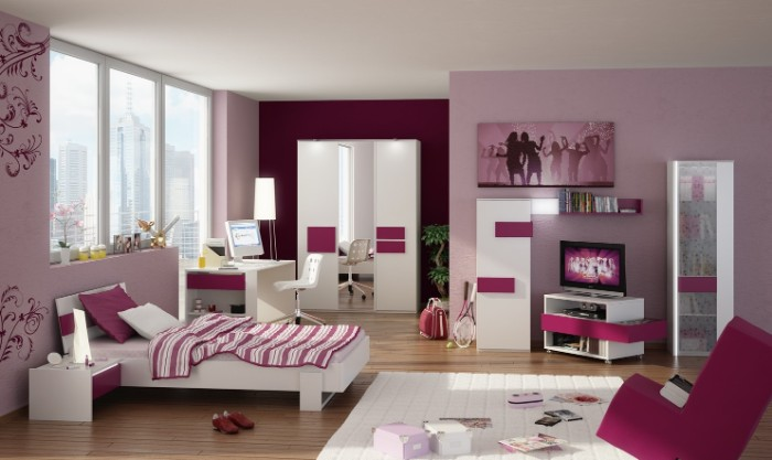 spacious room in pink, purple and white, with a large window, a bed and a wardrobe, cupboards and a tv