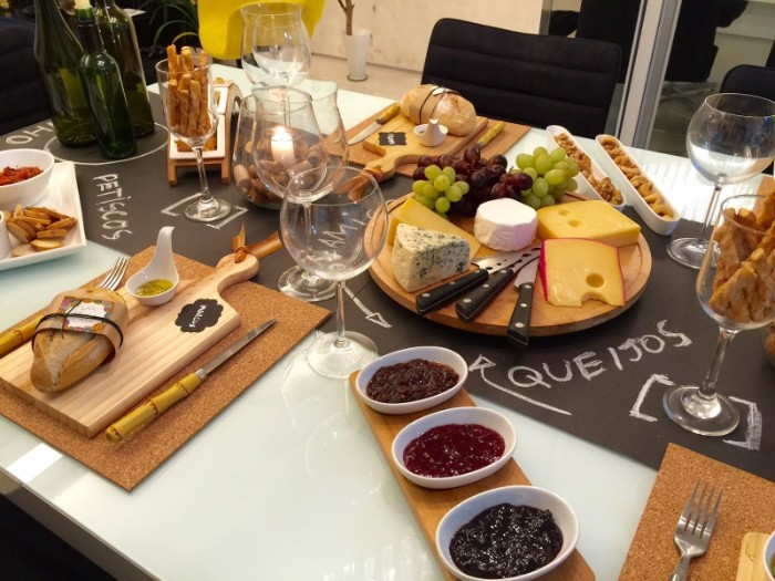 grapes and different kinds of cheese, on a table with dips, bread and crackers, 50th birthday party ideas, wine tasting table