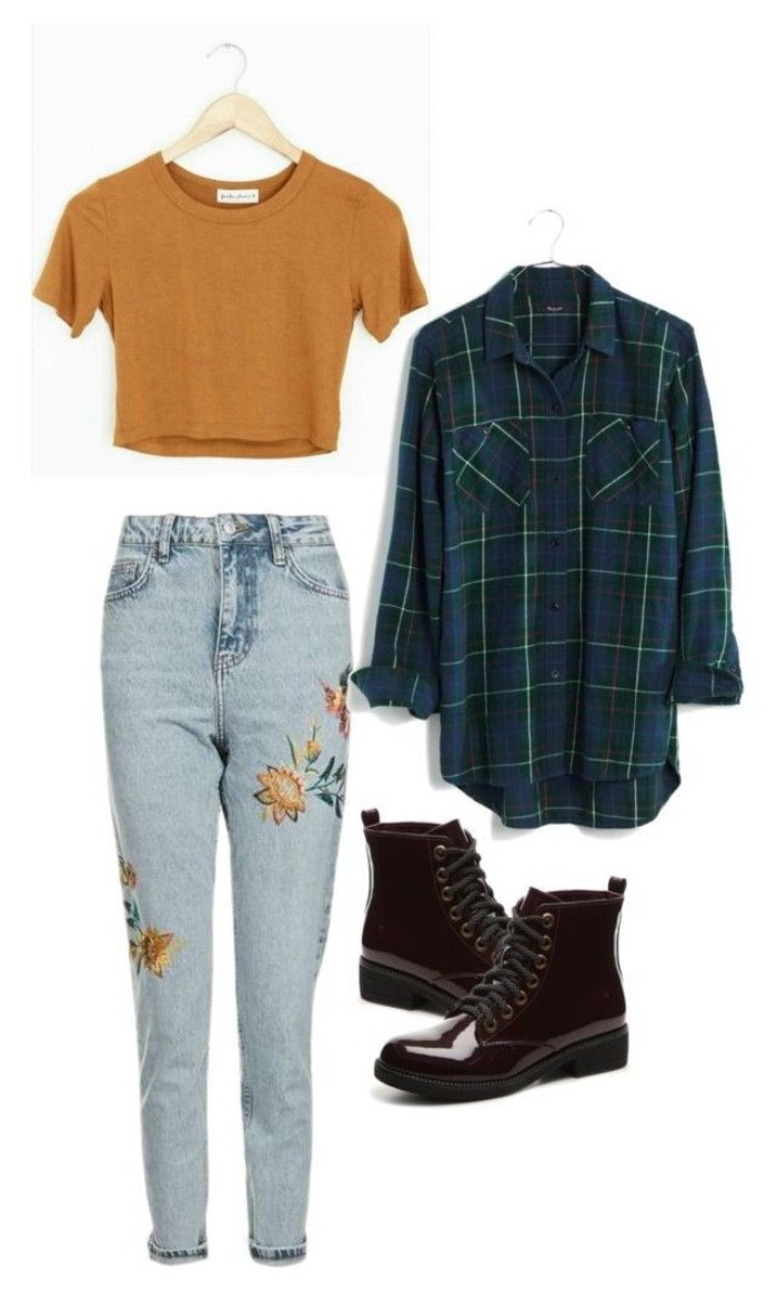 embroidered pale blue, high waisted acid wash jeans, featuring floral motives, grunge girl looks, cropped orange t-shirt, patent dark burgundy combat boots, oversized plaid shirt in dark green, white and dark blue