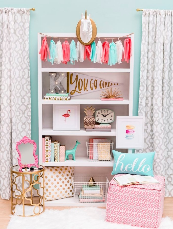 baby blue wall, with patterned curtains in white, and pale grey, teenage girl room ideas, white cupboard with five shelves, filled with books and various, pastel colored items