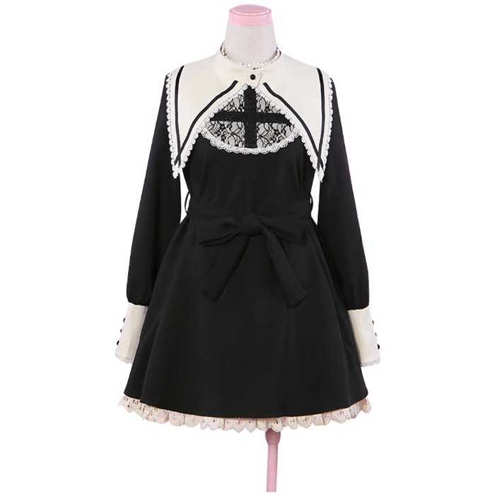 cross detail in black, on a black and white, lolita style dress, featuring a long white collar and cuffs, lace trims and a black belt