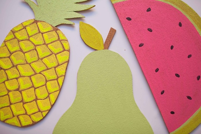 diys for your room, close up on four bulletin boards, made from painted cork, and shaped like fruit, pineaple and a pear, slice of watermelon