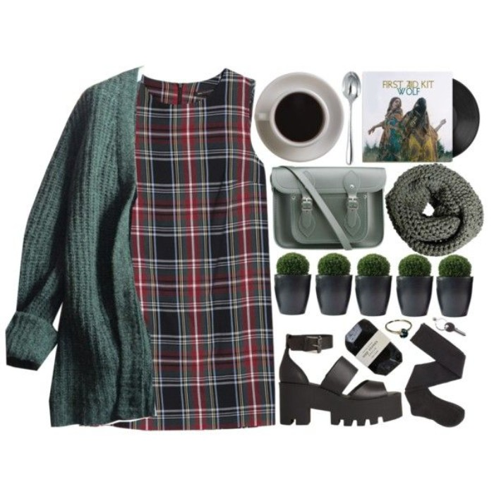 sleeveless plaid mini dress, in black and red, dark green and white, chunky heeled black sandal, fir green chunky knit oversized cardigan, 90s grunge clothing, black socks a grey tube scarf, a cross-body bag, and various accessories