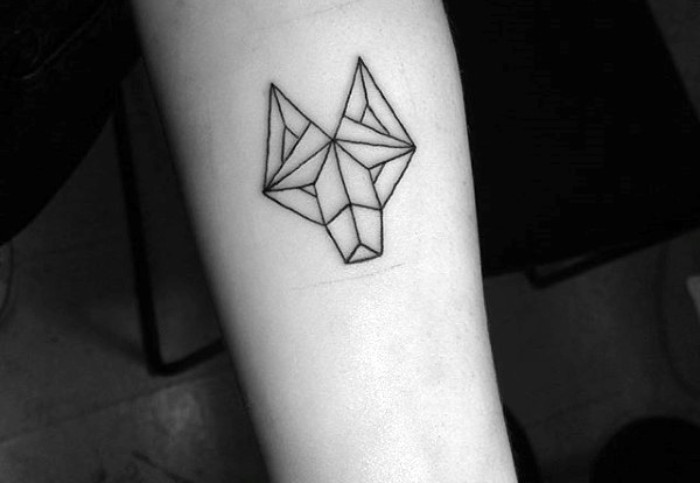 geometric line art of a wolf's head, tattooed in black ink, on a person's arm, minimalistic and creative design, cool arm tattoos