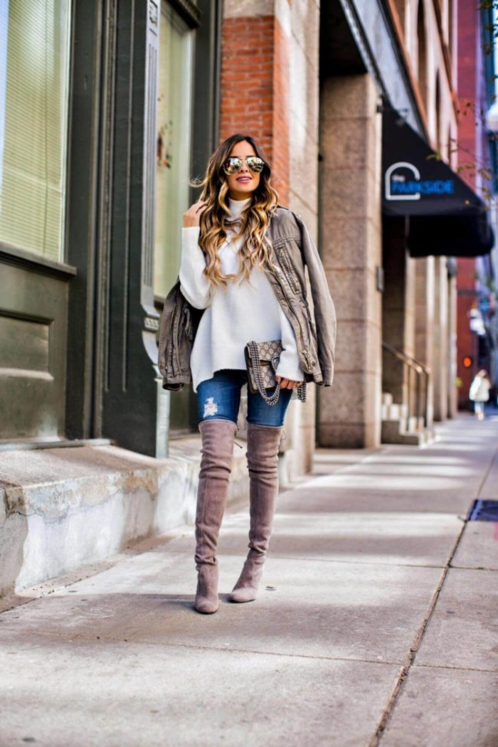 suede over-the-knee boots, in mink grey, worn with ripped skinny jeans, a baggy white polo neck jumper, and a creamy grey jacket