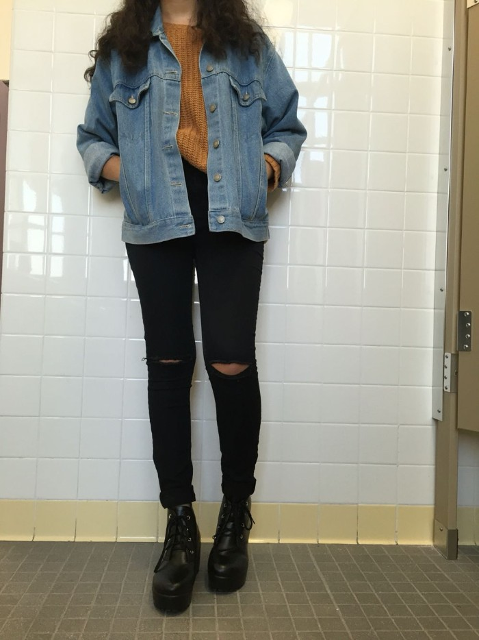 what a grunge girl looks like, ripped black skinny jeans, dark mustard yellow jumper, blue denim jacket, and black leather combat boots