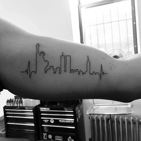 life line incorporating the new york city skape, as it was before 9/11, featuring the statue of liberty, the twin towers, and the empire state building, tattoos with deep meaning, on a man's arm