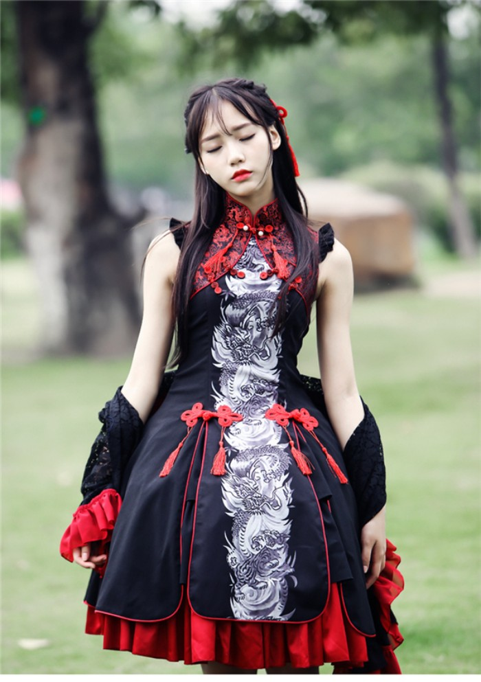 chinese inspired gothic lolita, in a black sleeveless dress, with grey and white dragon print, and red details