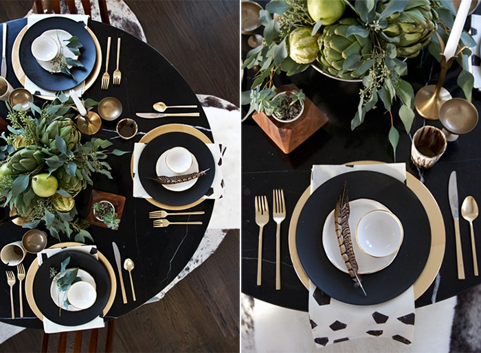 black round table, with gold and black and white dishes, and gold cutlery, thanksgiving dinnerware, green table centerpiece, featuring leaves and pears, gourds and artichokes