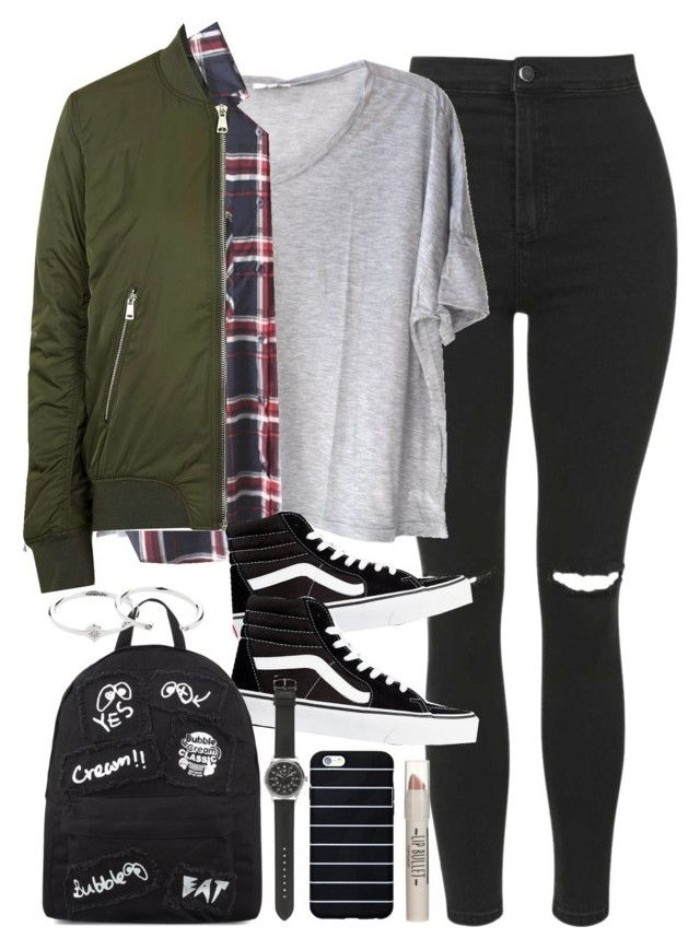 backpack in black, decorated with white scribbles, khaki green jacket, plaid shirt and a baggy, pale grey t-shirt, ripped black skinny jeans, black and white sneakers