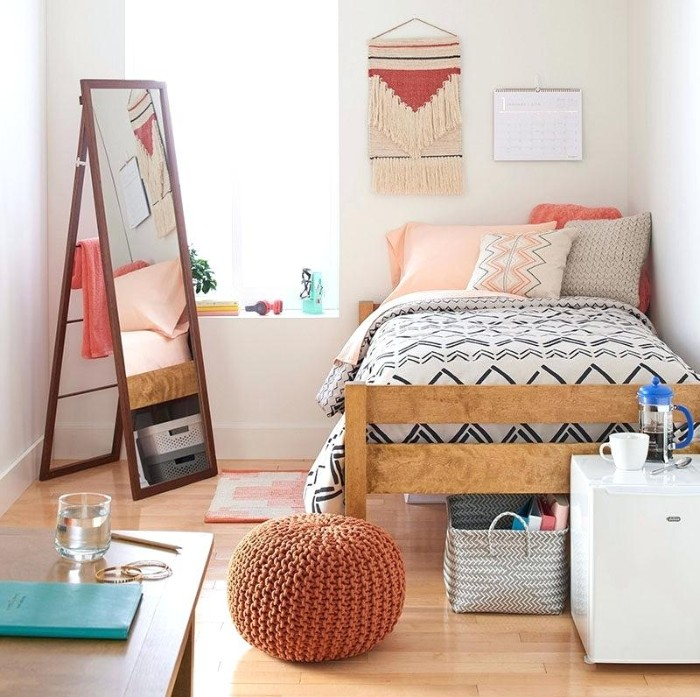 teenage bedroom ideas for small rooms, single bed with wooden frame, in a well lit room, with laminate floor, containing a tall mirror, a desk and a cupboard