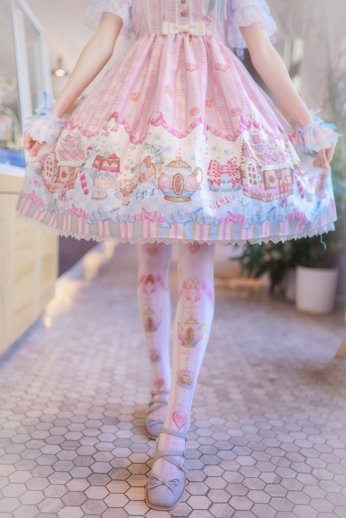 close up of a circular, pale pink skirt, with cute white and beige, blue and yellow motifs, what is lolita, worn over white patterned tights