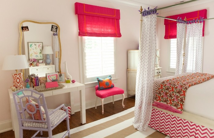 lavender colored chair, near a white desk, with a mirror in a gold frame, cute teen rooms, bed with white curtains, brown and white striped rug
