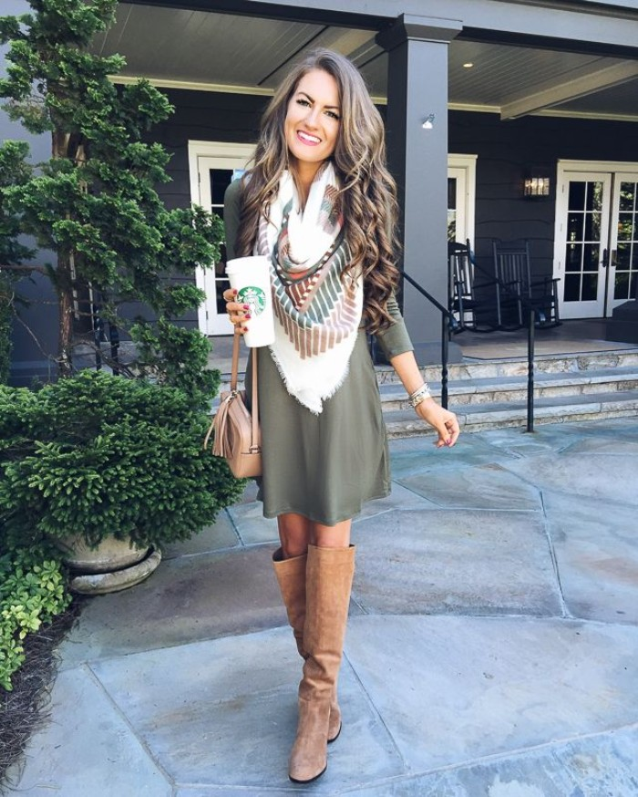 blanket scarf in white, with dark green and brown motifs, worn over a greyish-green jumper dress, comfy outfits, paired up with beige, suede over-the-knee boots