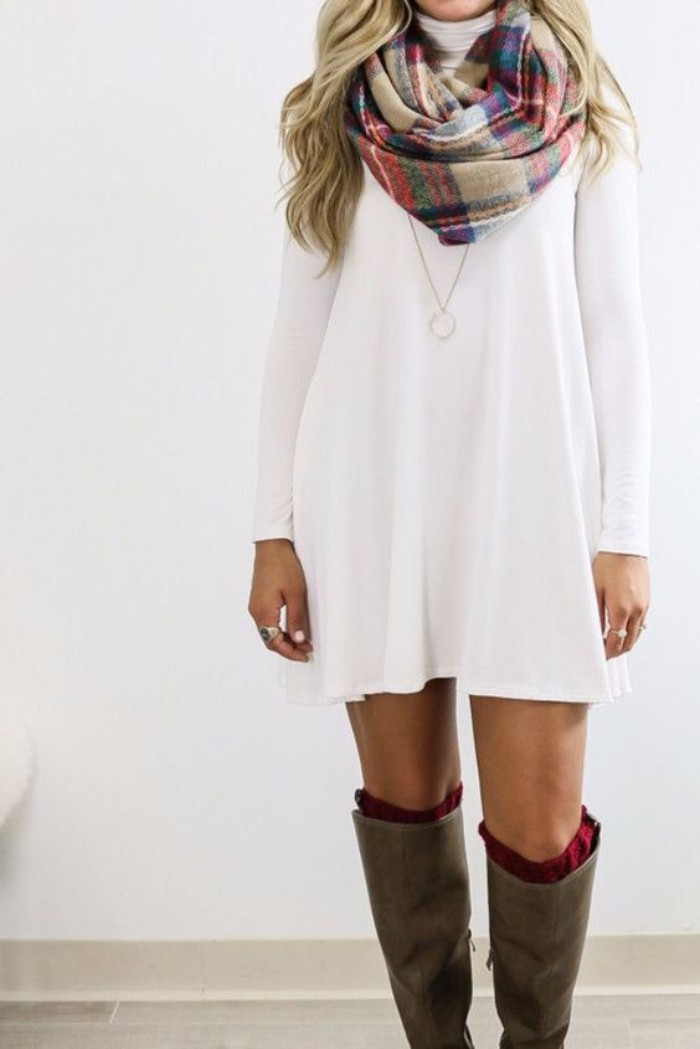 white long sleeved jumper mini dress, comfy outfits, combined with a plaid scarf, chunky red socks, and knee-high brown leather boots