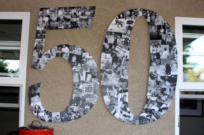 photographs in black and white, making up a large wall decoration, shaped like the number 50, on a beige wall, between two windows, birthday decoration ideas