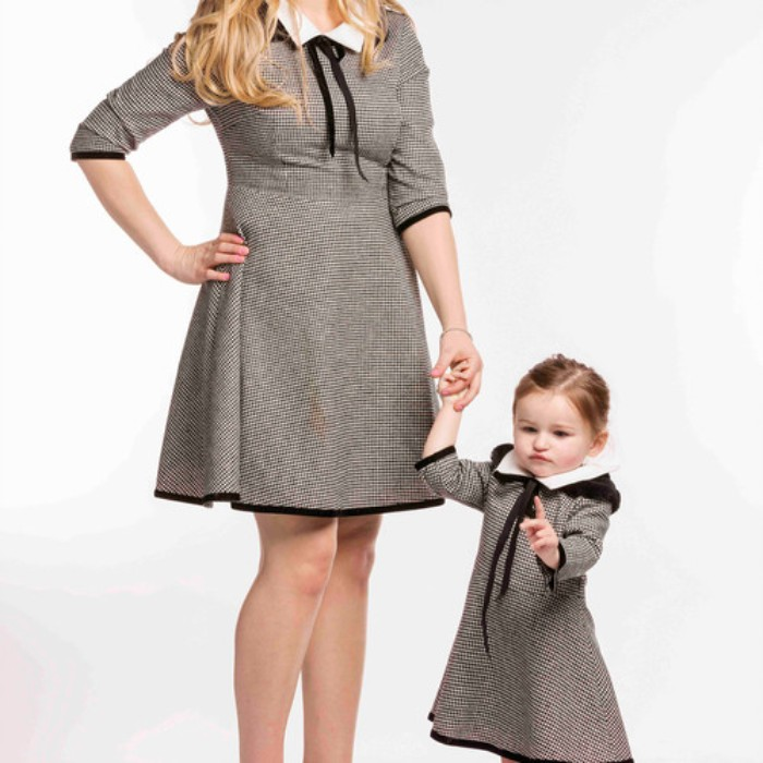identical dresses made from tweed, with quarter sleeves, and white collars, featuring black ribbons, cute thanksgiving outfits, worn by a mother and daughter