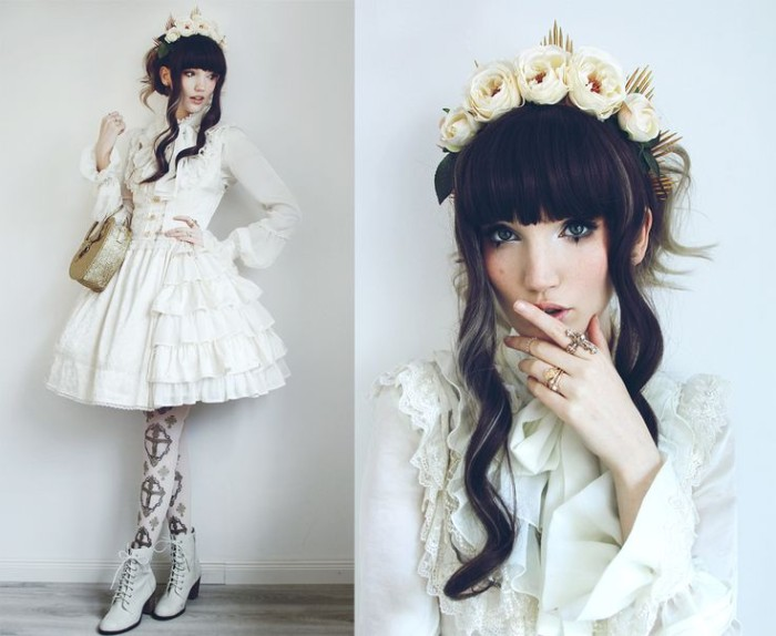 fake roses in cream, decorating the black hair of a japanese lolita, dressed in a white tiered dress, with lace and frills