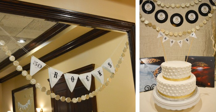 vinyl records and garlands, with the inscription 50 rocks, hanging over a white and gold cake, 50th birthday celebration ideas for husband, rock and roll party
