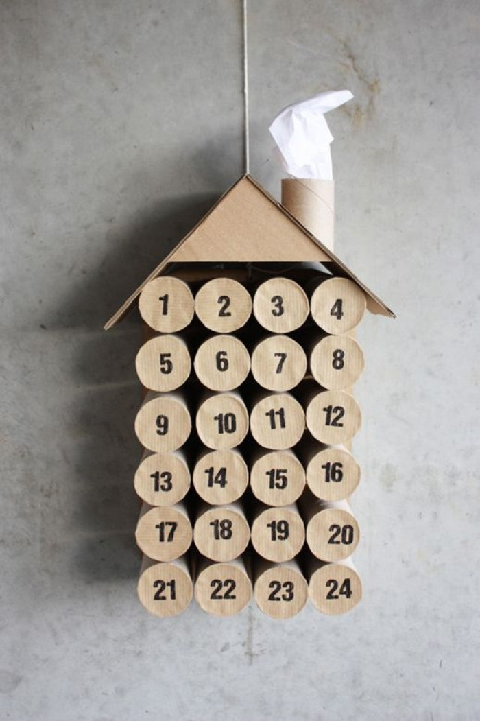 alternative way of using toilet paper rolls, to create an advent calendar, 24 toilet paper rolls, covered with beige paper, placed in four rows of six, with a roof and a chimney, made of beige card