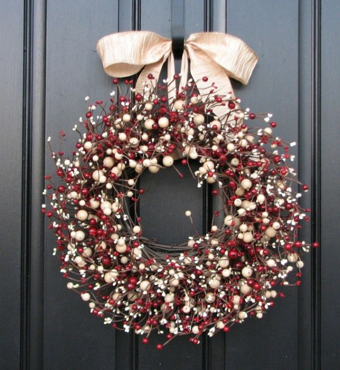 thin branches twisted together, to form a wreath, with lots of white, and red berries, in different sizes, diy wreath suggesions, pale gold bow on top