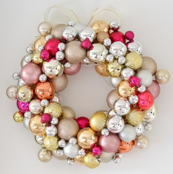 baubles in silver and gold, and different shades of pink, in various sizes, stuck together to form a wreath, christmas wreath ideas, sheer gold bow on top