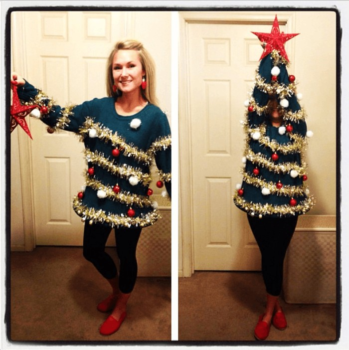 blonde smiling woman, wearing a dark blue jumper, decorated with gold garlands, featuring red and white baubles, diy ugly christmas sweater, next image shows her with raised arms, resembling an xmas tree, with a red star on top