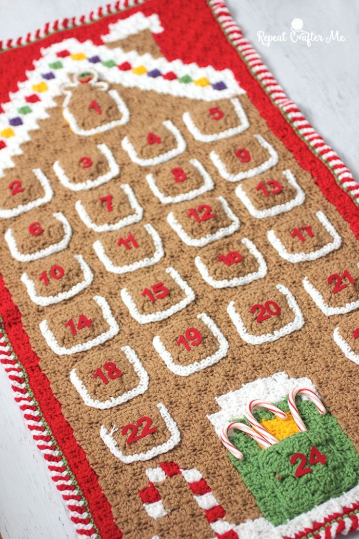fun advent calendars, beige and red, crochet advent calendar, with white and yellow, green and blue details, and 24 numbered pockets