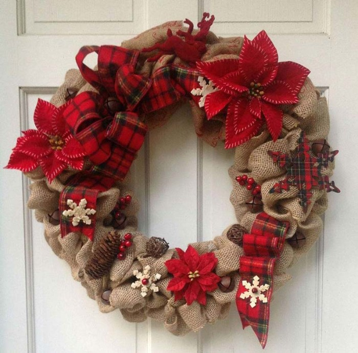 burlap festive wreath, decorated with fir cones, tiny red faux berries, snowflake ornaments and poinsettia flowers, made from red felt, wreath ideas, red tartan ribbon, tied in a bow