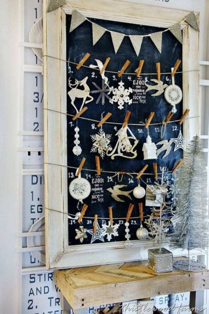another suggestion for a blackboard, advent calendar diy, various christmas tree ornaments, hanging on pieces of string, attached to a framed blackboard