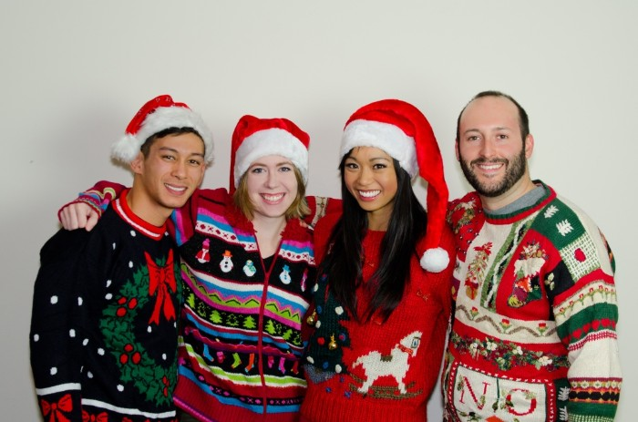 group of four smiling friends, wearing tacky, multicolored jumpers with various festive patterns, ugly christmas sweater ideas, snowmen and a christmas wreath, rocking horse and santas