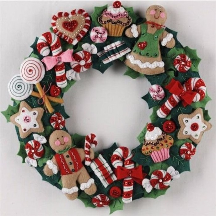 felt wreath featuring various shapes, of candy and sweets, gingerbread man and woman, lollypops and cupcakes, cookies and candy canes