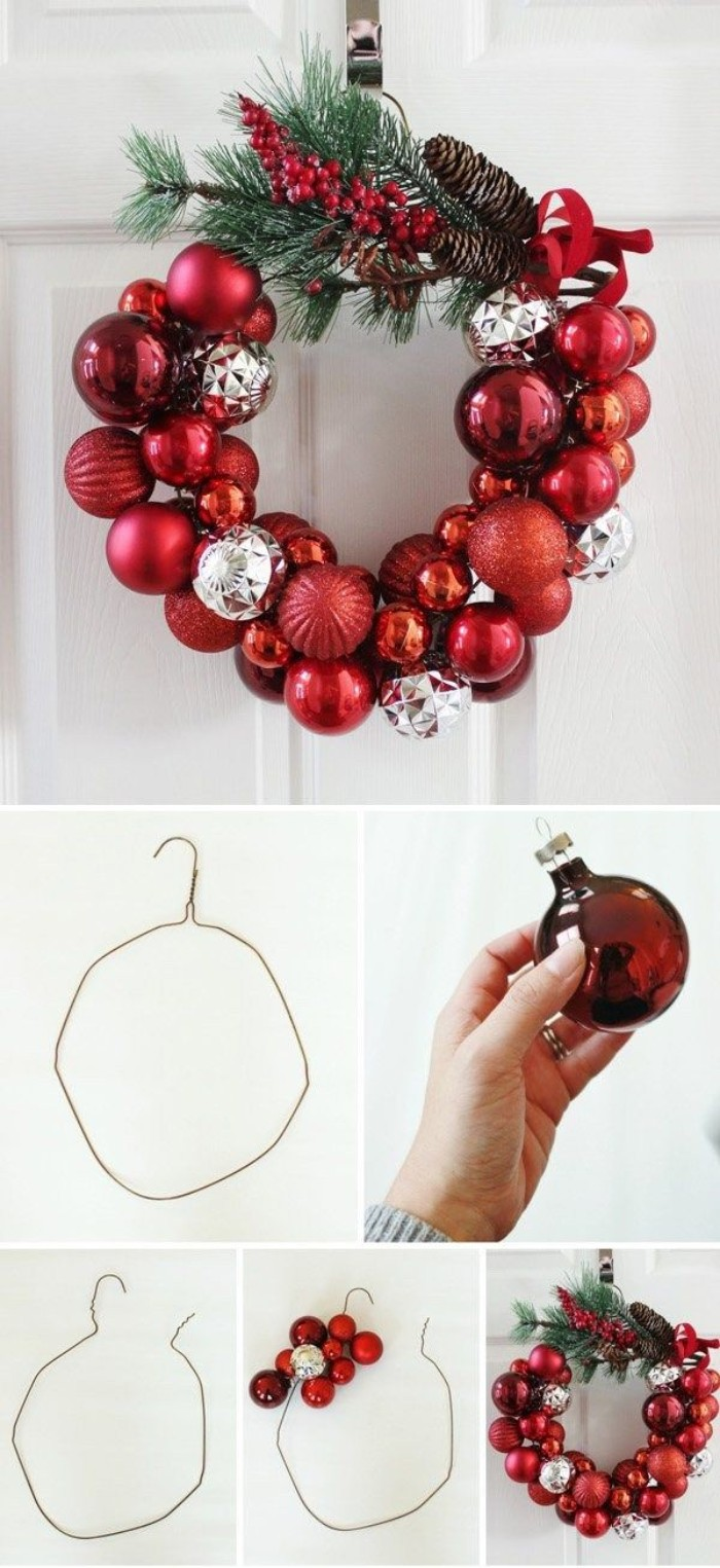 coathanger made of metal, twisetd into a hoop, and decorated with red, and silver christmas baubles, and some pine branches, pine cones and red berries, stuck to the hoop with glue