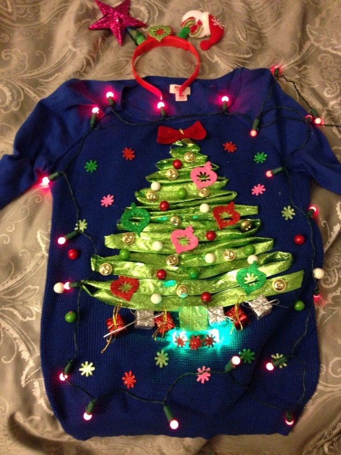 lime green ribbon, shaped like an xmas tree, and stuck on a dark blue jumper, decorated with glowing christmas lights, diy ugly christmas sweater, with multicolored beads and small flowers