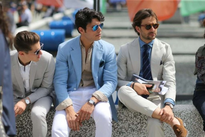 what is semi formal attire, three men with sunglasses, sitting next to each other, wearing white trousers, light colored shirts, and off-white and pale blue blazers