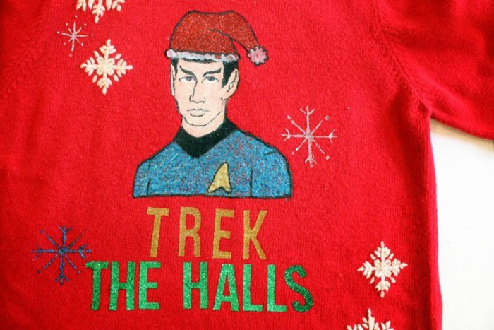 mr. spock hand-drawn on a red, cute ugly christmas sweater, decorated with blue and white snowflakes, and the words trek the halls