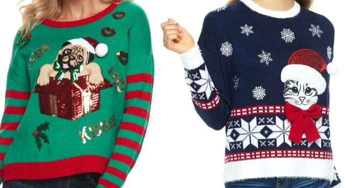 kitten and puppy, wearing christmas hats, on a green and red, and a dark navy, white and red jumpers, ugly sweater ideas, worn by two women