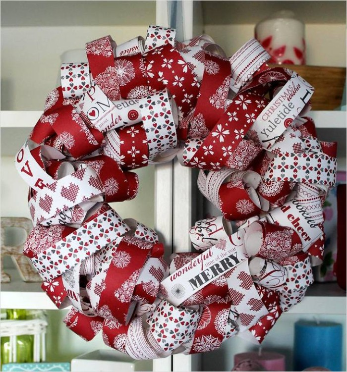 an alternative way of making a christmas wreath, using rolled patterned paper, in white and red, with festive motifs and messages