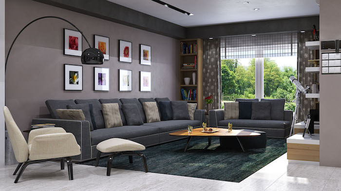 dark grey walls, large dark grey sofas with beige and black throw pillows, tiled floor with dark green carpet, interior design ideas