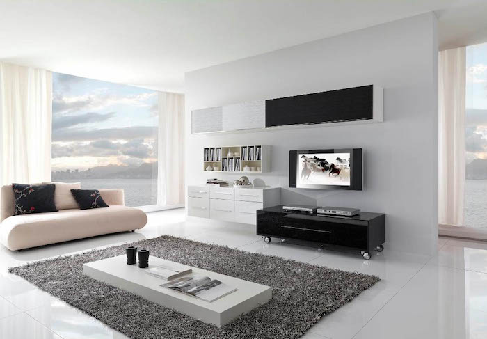 white walls, white tiled floor, dark grey carpet, white sofa with black throw pillows, white and black bookshelves, small white coffee table, how to decorate a small living room
