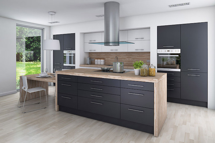 black cabinets and drawers, beautiful kitchens, wooden kitchen island, tiled backsplash, beautiful kitchens