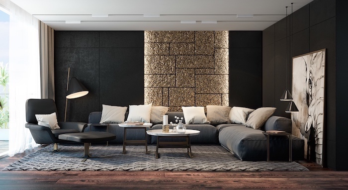 black and gold sequinned tiled wall, accent wall living room, grey corner sofa, wooden floor