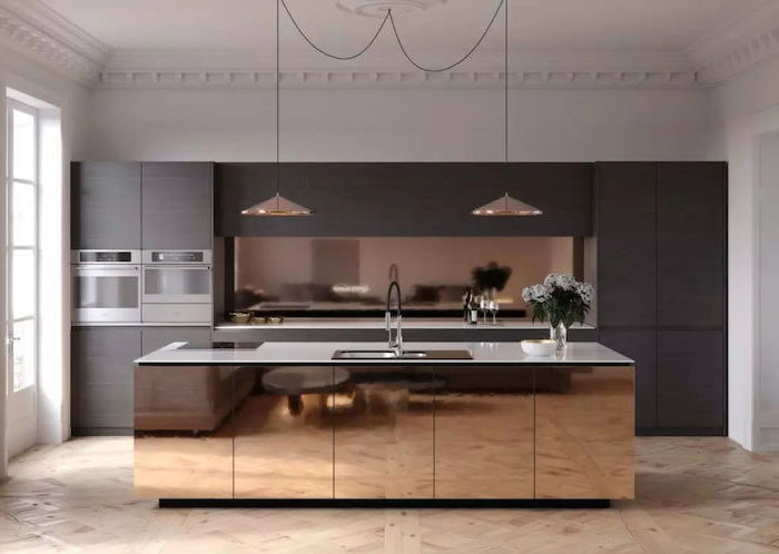wooden cabinets and drawers, kitchen wall decor ideas, brass kitchen island, white counters