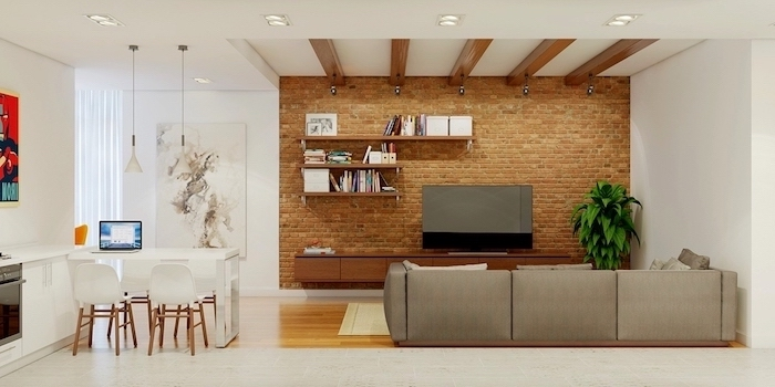 brick wall, grey sofa, living room wall colors, wooden bookshelves and cabinet, wooden floor