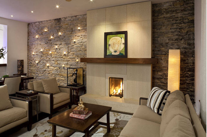 brick wall with lights around the fireplace, beige sofa and armchairs, dining room wall decor